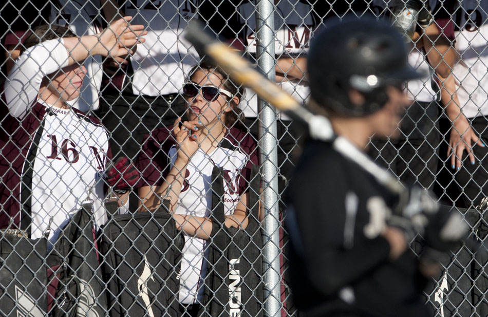Mishawaka's Sarah Ultreras, center, watches the action from the dugout during a softball sectional game on Tuesday, May 22, 2012, at Penn High School in Mishawaka. (James Brosher/South Bend Tribune)