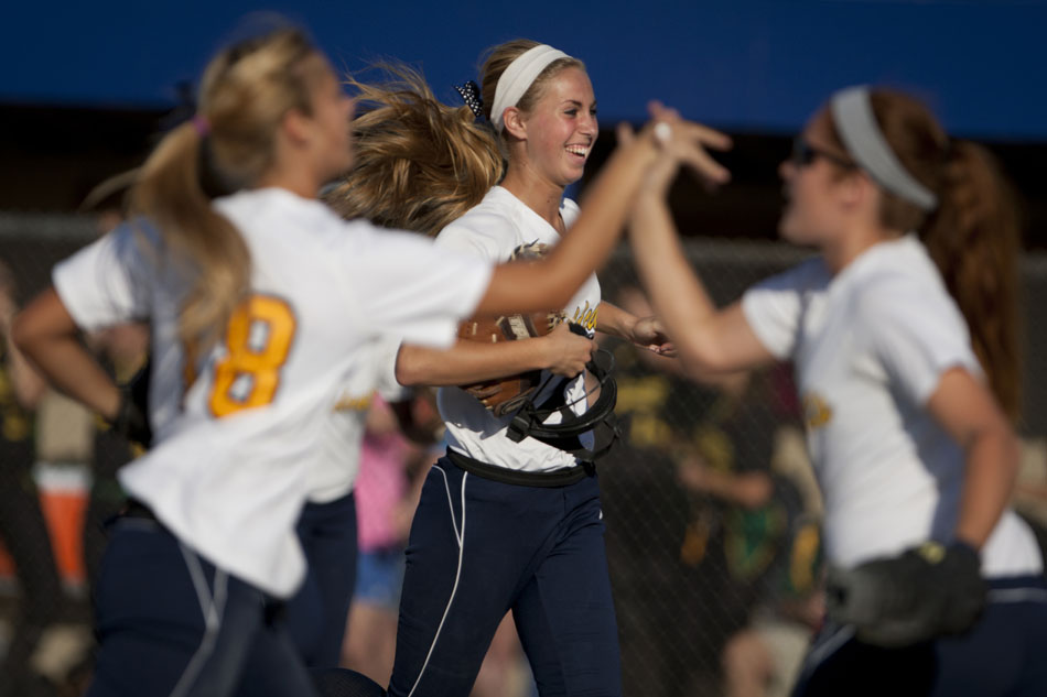 Riley's Morgan Allison, background, runs off the field in celebration after a third out to end an inning during a Class 4A softball regional final on Tuesday, May 29, 2012, at Riley High School in South Bend. (James Brosher/South Bend Tribune)