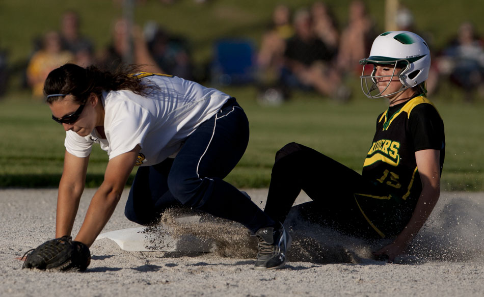Northridge's Jaymee Bowers, right, slides safely into second as Riley's Angela Danielli tries to corral a throw from the outfield during a Class 4A softball regional final on Tuesday, May 29, 2012, at Riley High School in South Bend. (James Brosher/South Bend Tribune)
