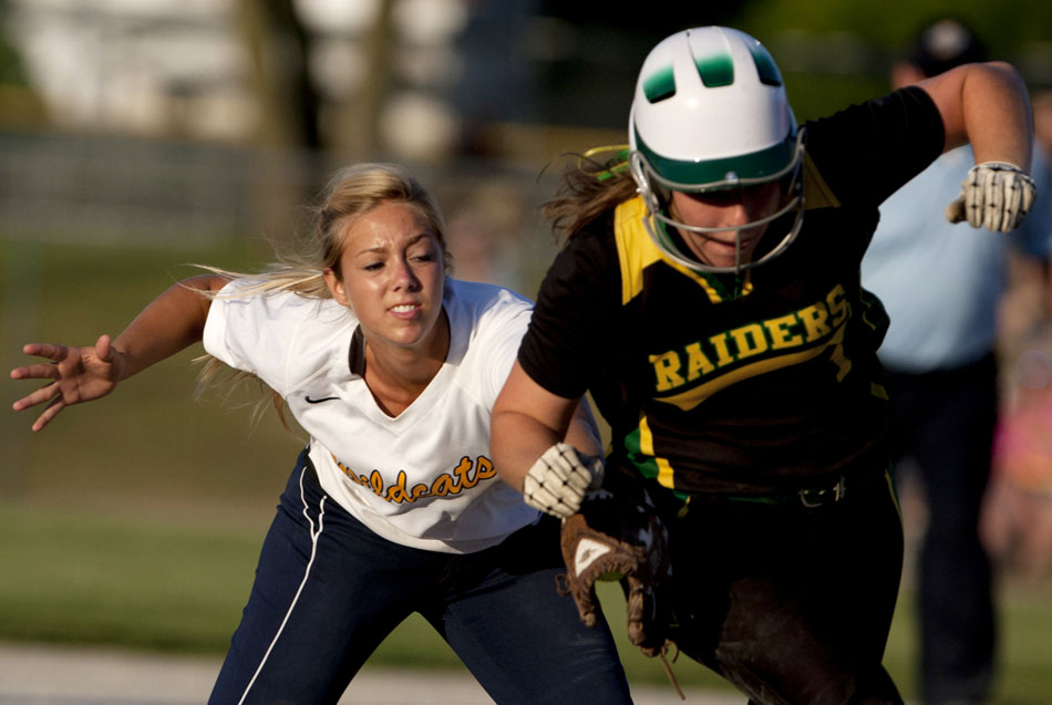 Riley's Allison Luft, left, applies the tag to Northridge's Madison Schrock between second and third during a Class 4A softball regional final on Tuesday, May 29, 2012, at Riley High School in South Bend. (James Brosher/South Bend Tribune)