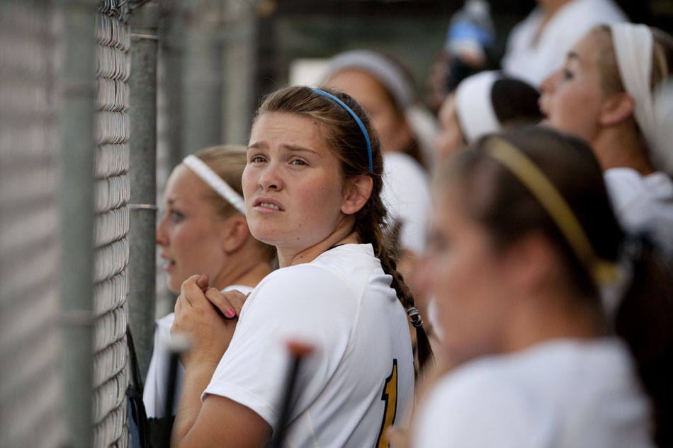 Riley players watch the action from the dugout during a Class 4A softball regional final on Tuesday, May 29, 2012, at Riley High School in South Bend. (James Brosher/South Bend Tribune)