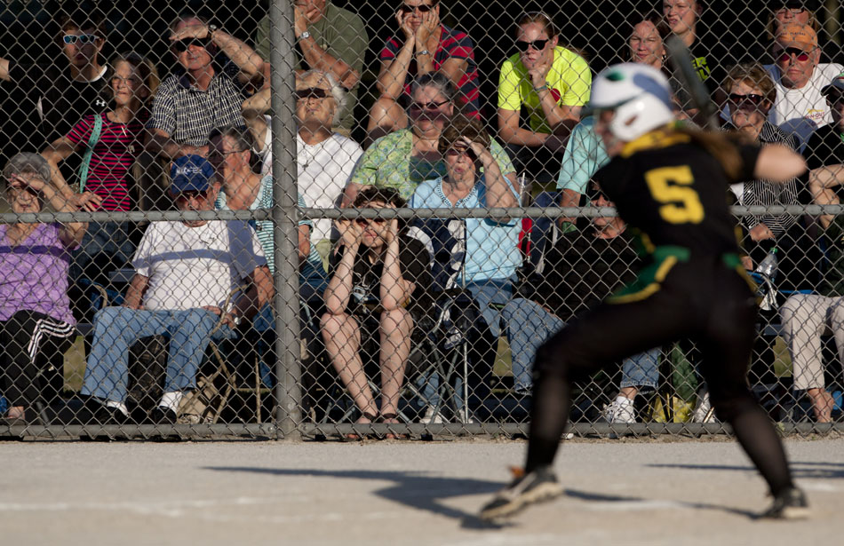 Northridge fans watch as Cooner Crist eyes a pitch during a Class 4A softball regional final on Tuesday, May 29, 2012, at Riley High School in South Bend. (James Brosher/South Bend Tribune)