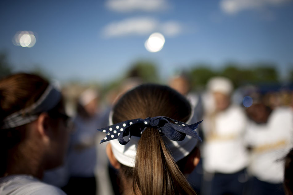 A Riley player wears a bow in her hair with the school's colors before a Class 4A softball regional final on Tuesday, May 29, 2012, at Riley High School in South Bend. (James Brosher/South Bend Tribune)