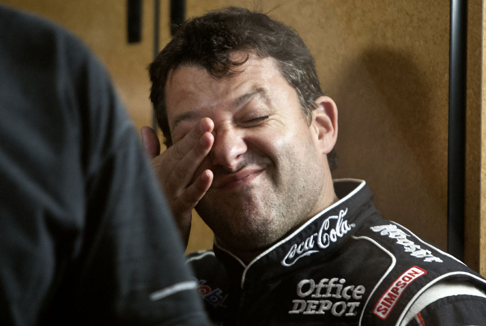 NASCAR driver Tony Stewart reacts after arriving to his team trailer on Saturday, June 16, 2012, at Plymouth Speedway. Stewart's arrival just before 10 p.m. coincided with a thunderstorm's arrival at the speedway, halting the on-track racing. (James Brosher/South Bend Tribune)