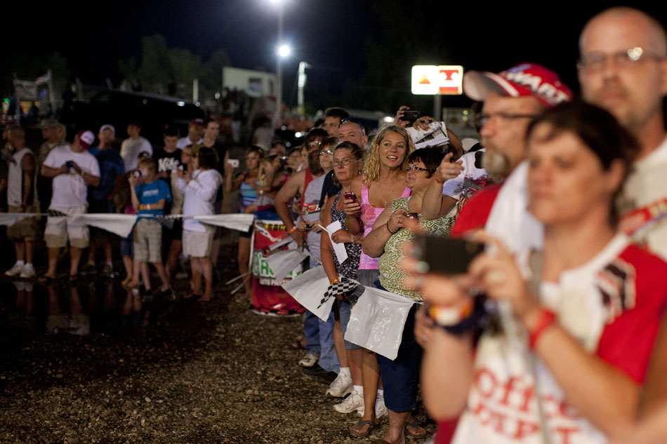 With camera phones ready, several fans await the arrival of NASCAR driver Tony Stewart outside of his pit area on Saturday, June 16, 2012, at Plymouth Speedway. (James Brosher/South Bend Tribune)