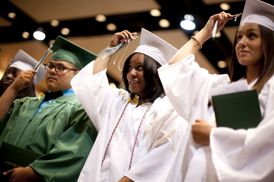 Washington High School graduates move their tassels at the end of Washington High School commencement exercises on Saturday, June 9, 2012, at the Century Center in downtown South Bend. (James Brosher/South Bend Tribune)