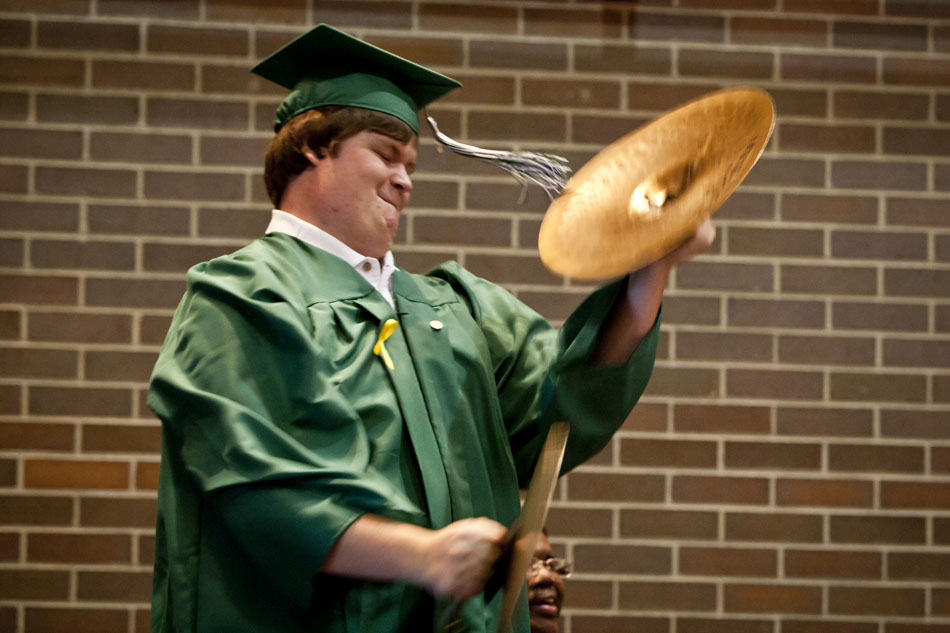 "A Washington High School graduate plus one last time with the school's band as they perform the ""William Tell Overture"" during the school's commencement exercises on Saturday, June 9, 2012, at the Century Center in downtown South Bend. (James Brosher/South Bend Tribune)"