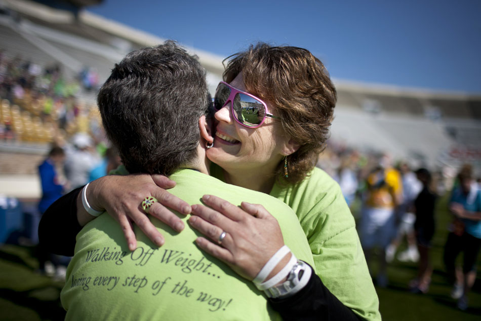 Kimmie Trethewey shares a hug with a member of her walking group after finishing the Sunburst 5K Walk on Saturday, June 2, 2012, at Notre Dame Stadium. (James Brosher/South Bend Tribune)