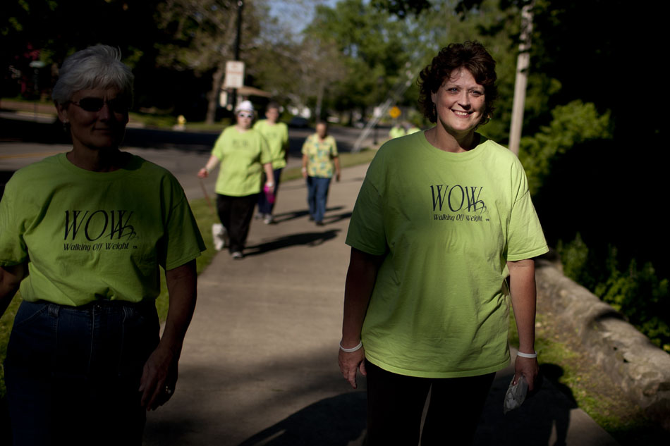 Kimmie Trethewey, right, walks with her walking group through Battell Park on Tuesday, May 22, 2012, in Mishawaka. (James Brosher/South Bend Tribune)