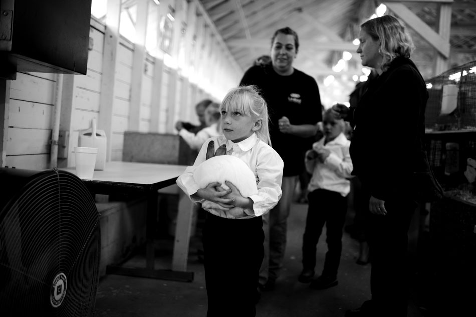 Kloe Kiggins, 5, of Niles, carries her rabbit, 3T, to the judging area for the rabbit showmanship portion of the show during the Berrien County Youth Fair on Monday, Aug. 13, 2012, in Berrien Springs, Mich. (James Brosher/South Bend Tribune)