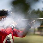 David Morgan from Arvada, Colo., fires an American-revolution era Brown Bess musket during a demonstration for visitors during the first day of Fort D.A. Russell Days, an event coinciding with Cheyenne Frontier Days, on Friday, July 22, 2011, at F.E. Warren Air Force Base in Cheyenne. (James Brosher/Wyoming Tribune Eagle)
