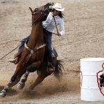 Sarah Kieckhefer from Prescott, Ariz. rounds the third barrel on her horse during the first go of barrel racing on Tuesday, July 19, 2011, at Frontier Park. Kieckhefer finished the run with a time of 18.71 seconds. (James Brosher/Wyoming Tribune Eagle)