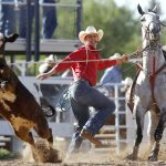 Matt Kenney from Onawa, Iowa hops off his horse and chases down a calf after he roped it during the first go of slack tie-down roping on Wednesday, July 20, 2011, at Frontier Park. (James Brosher/Wyoming Tribune Eagle)