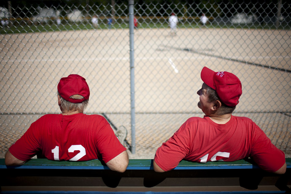 Carl Montgomery, right, and Mike Smith, both players on the Irene's Cafe team, watch the action from the bench during a Mishawaka senior softball league game on Tuesday, July 31, 2012, at Normain Park in Mishawaka. (James Brosher/South Bend Tribune)
