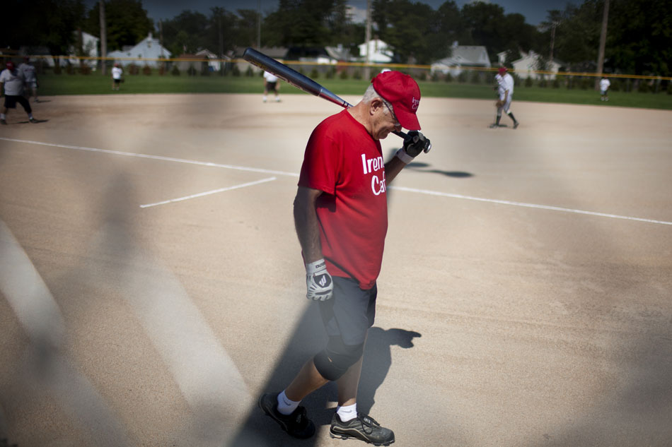 Bob Matuszak, a player on the Irene's Cafe team, waits in the on-deck circle for his turn to bat during a Mishawaka senior softball league game on Tuesday, July 31, 2012, at Normain Park in Mishawaka. (James Brosher/South Bend Tribune)