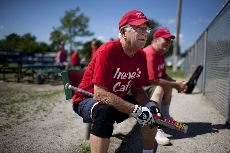 Bob Matuszak, a player on the Irene's Cafe team, waits on the bench for his turn to bat during a Mishawaka senior softball league game on Tuesday, July 31, 2012, at Normain Park in Mishawaka. The league is for players 62 and older. It features a wide first base, and two home plates to help the older players avoid collisions. (James Brosher/South Bend Tribune)