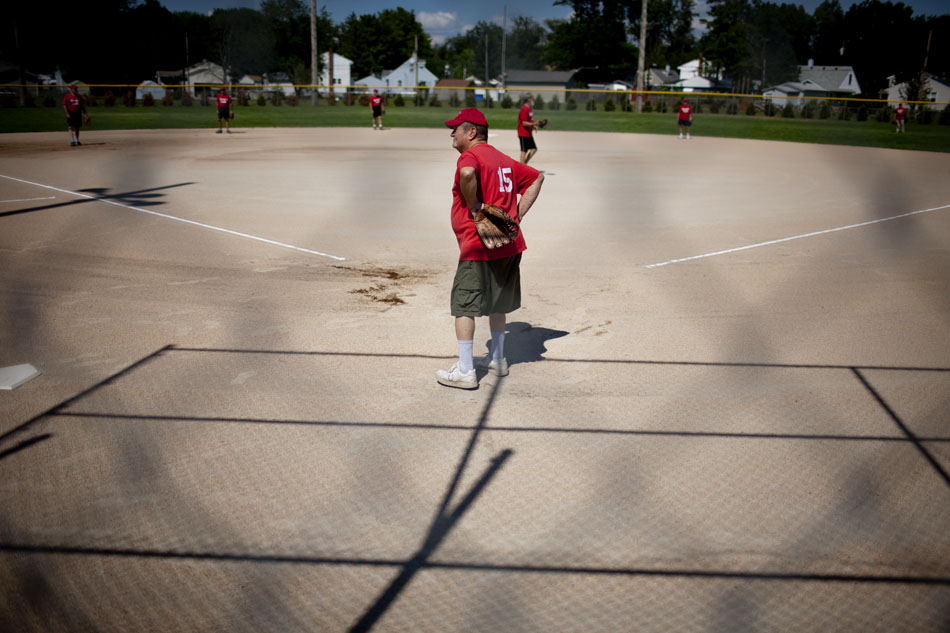 Carl Montgomery, catcher for the Irene's Cafe team, waits at home plate for a batter during a Mishawaka senior softball league game on Tuesday, July 31, 2012, at Normain Park in Mishawaka. At 77 Montgomery is one of the oldest members of the team, all of whom must be 62 or older to participate in the league. (James Brosher/South Bend Tribune)