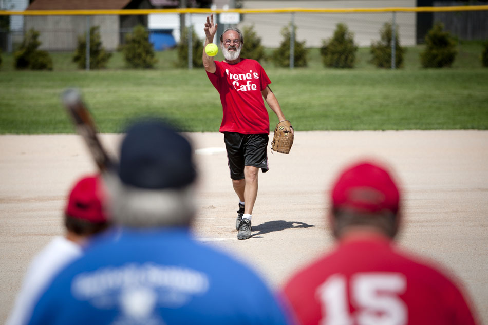 Jeff Chamberlin, a player on the Irene's Cafe team, pitches during a Mishawaka senior softball league game on Tuesday, July 31, 2012, at Normain Park in Mishawaka. The league is for players 62 and older. It features a wide first base, and two home plates to help the older players avoid collisions. (James Brosher/South Bend Tribune)