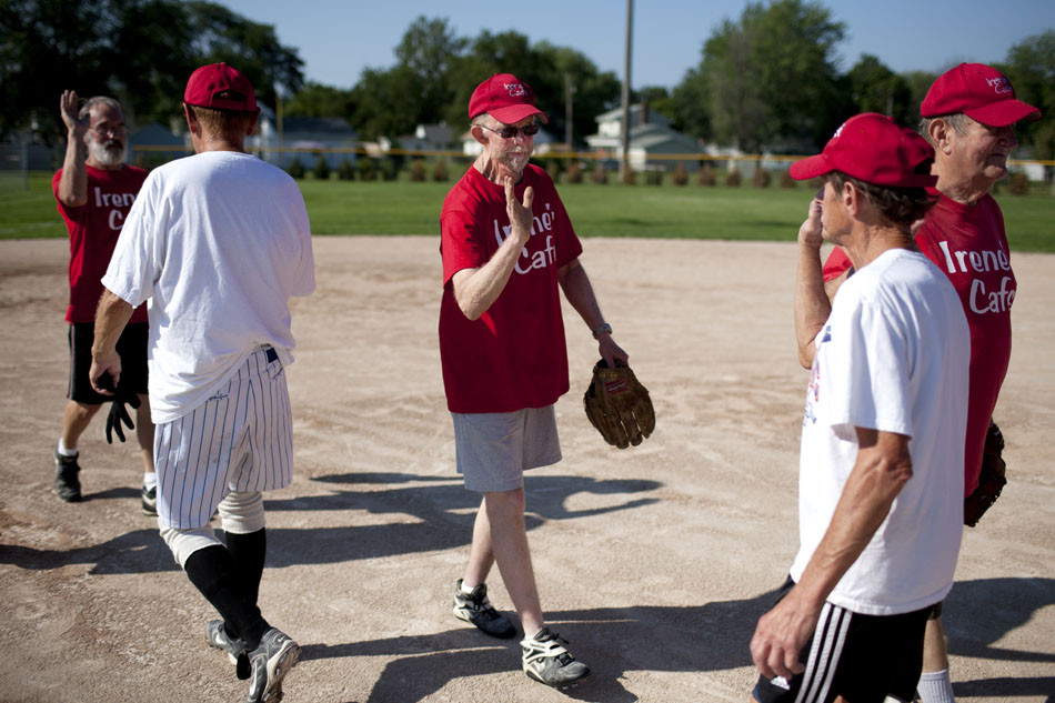 After a victory, the Irene's Cafe team high fives the opposing team after a Mishawaka senior softball league game on Tuesday, July 31, 2012, at Normain Park in Mishawaka. (James Brosher/South Bend Tribune)