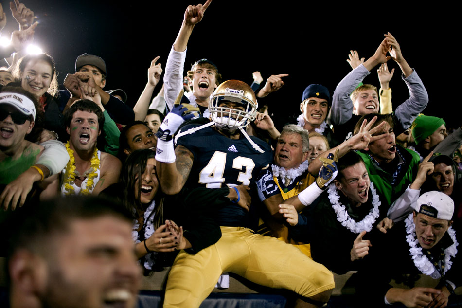 Notre Dame cornerback Josh Atkinson celebrates with the Irish student section after a win against Michigan on Saturday, Sept. 22, 2012, at Notre Dame. (James Brosher/South Bend Tribune)