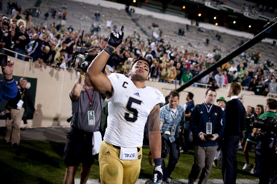Notre Dame linebacker Manti Te'o points to the sky as he leaves the field after a 20-3 win against Michigan State on Saturday, Sept. 15, 2012, in East Lansing, Mich. Te'o lost his girlfriend and his grandmother this week. (James Brosher/South Bend Tribune)