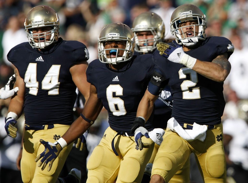 Notre Dame players Carlo Calabrese (44), KeiVarae Russell (6) and Bennett Jackson (2) celebrate after Jackson picked off a pass during a NCAA college football game on Saturday, Sept. 8, 2012, at Notre Dame. (James Brosher/South Bend Tribune)