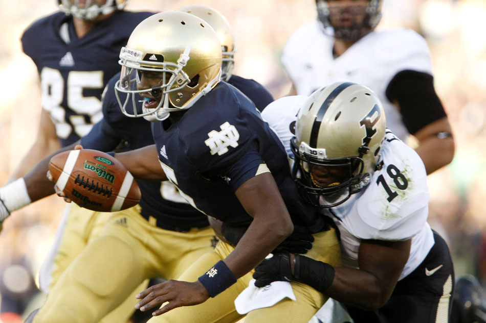 Notre Dame quarterback Everett Golson is sacked by Purdue linebacker Nnamdi Ezenwa during a NCAA college football game on Saturday, Sept. 8, 2012, at Notre Dame. (James Brosher/South Bend Tribune)