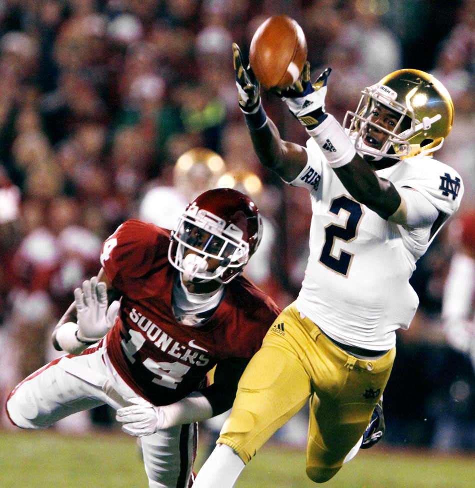 A pass intended for Notre Dame wide receiver Chris Brown (2) lands just out of reach as Oklahoma defensive back Aaron Colvin (14) defends during an NCAA college football game on Saturday, Oct. 27, 2012, in Norman, Okla. (James Brosher/South Bend Tribune)