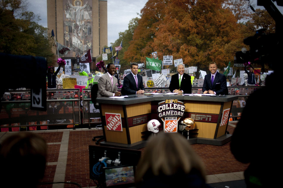"Hosts Desmond Howard, Chris Fowler, Lee Corso and Kirk Herbstreit are seen during a broadcast of ESPN's ""College GameDay"" on Saturday, Oct. 13, 2012, at Notre Dame. (James Brosher/South Bend Tribune)"