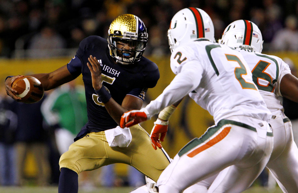 Notre Dame quarterback Everett Golson (5) evades Miami defenders during a NCAA college football game on Saturday, Oct. 6, 2012, at Soldier Field in Chicago. (James Brosher/South Bend Tribune)