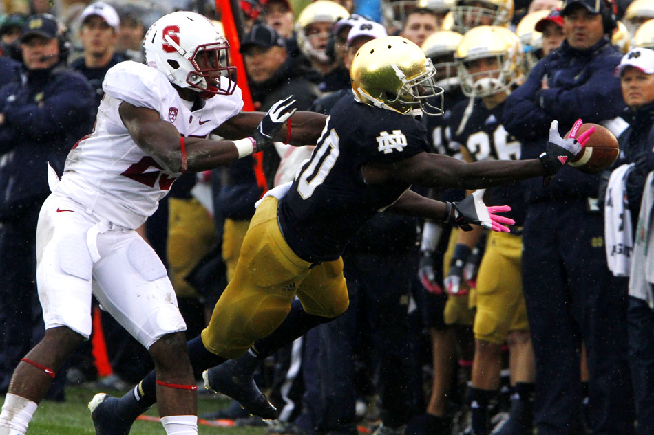 The ball lands just out of reach of Notre Dame wide receiver DaVaris Daniels in front of Stanford cornerback Alex Carter during a NCAA college football game on Saturday, Oct. 13, 2012, at Notre Dame. (James Brosher/South Bend Tribune)