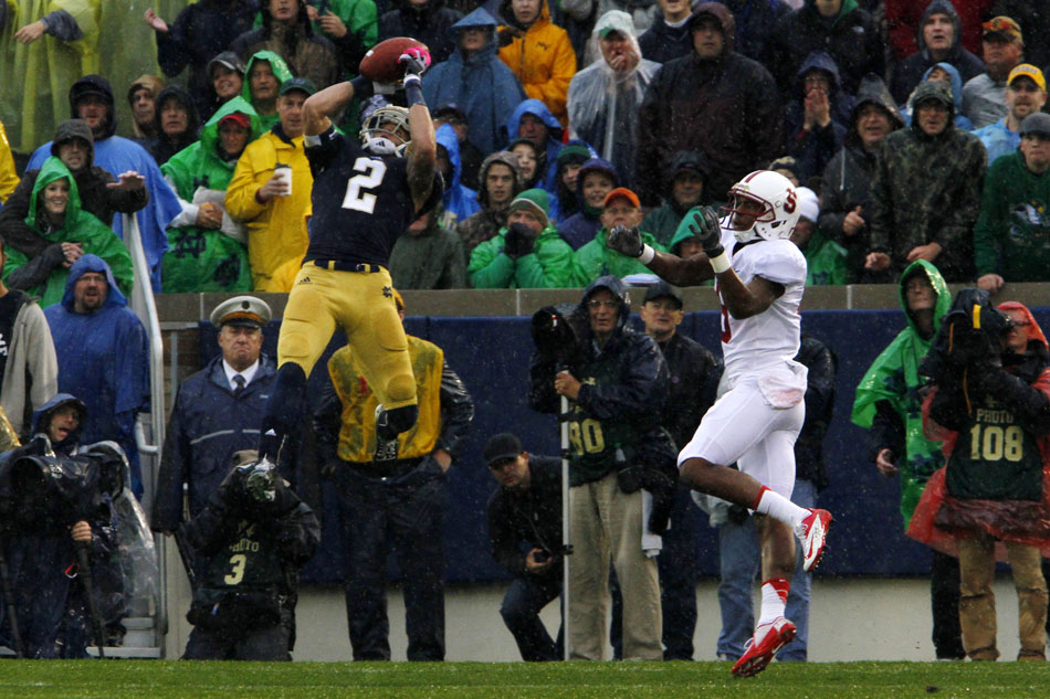 Notre Dame cornerback Bennett Jackson (2) picks off a pass near the end zone from Stanford quarterback Josh Nunes intended for tight end Brandon Gottfried, right, during a NCAA college football game on Saturday, Oct. 13, 2012, at Notre Dame. (James Brosher/South Bend Tribune)