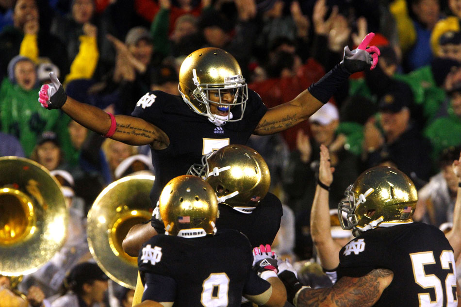 Notre Dame wide receiver TJ Jones, center, celebrates after scoring what proved to be the game-winning touchdown in overtime during a NCAA college football game against Stanford on Saturday, Oct. 13, 2012, at Notre Dame. (James Brosher/South Bend Tribune)