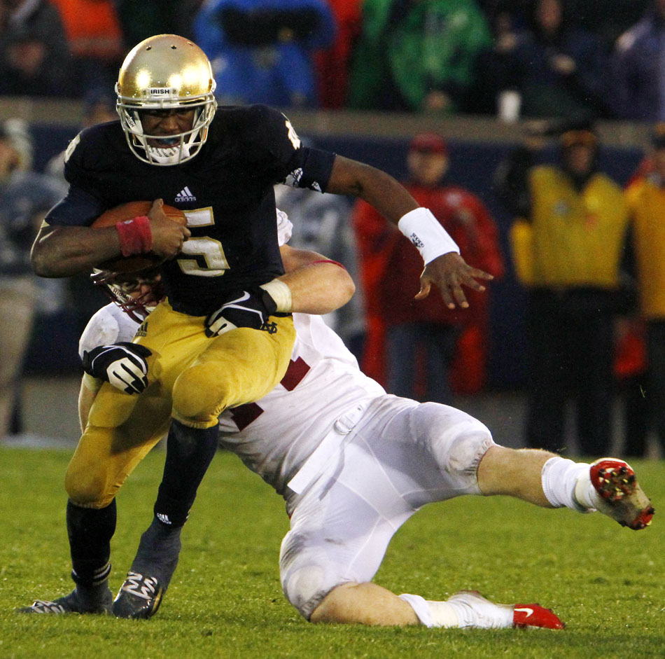 Stanford linebacker Chase Thomas tackles Notre Dame quarterback Everett Golson during a NCAA college football game on Saturday, Oct. 13, 2012, at Notre Dame. Golson sustained a head injury on the play and was out the remainder of the game. (James Brosher/South Bend Tribune)