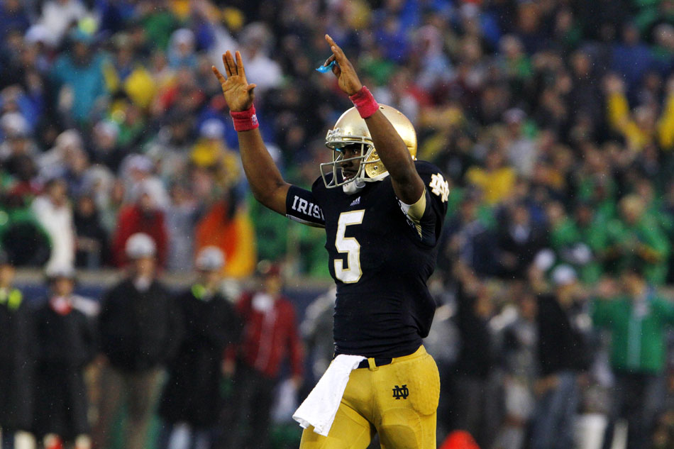 Notre Dame quarterback Everett Golson celebrates after throwing a touchdown to tight end Tyler Eifert during a NCAA college football game on Saturday, Oct. 13, 2012, at Notre Dame. (James Brosher/South Bend Tribune)