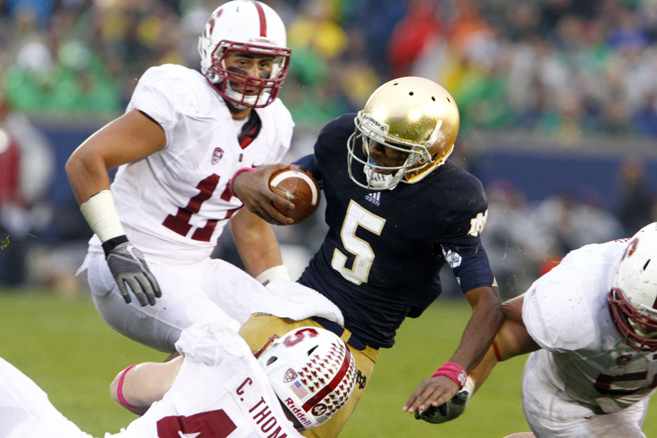 Notre Dame quarterback Everett Golson (5) is tackled by Stanford defenders during a NCAA college football game on Saturday, Oct. 13, 2012, at Notre Dame. (James Brosher/South Bend Tribune)
