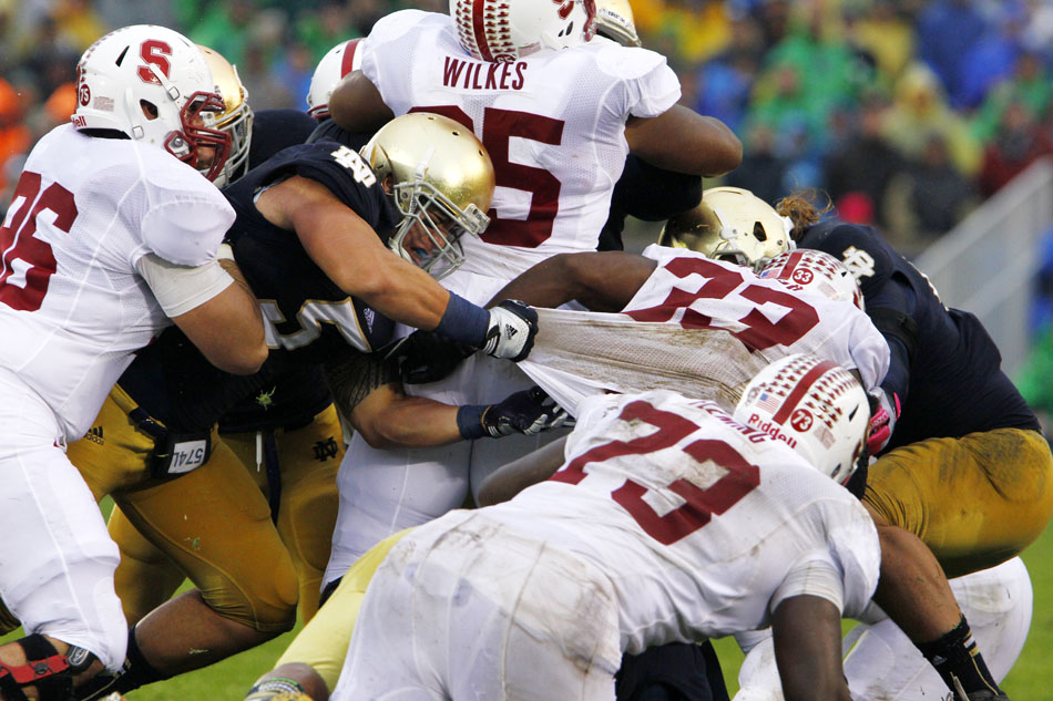 Notre Dame linebacker Manti Te'o (5) tries to stop Stanford running back Stepfan Taylor (33) by the jersey during a NCAA college football game on Saturday, Oct. 13, 2012, at Notre Dame. (James Brosher/South Bend Tribune)