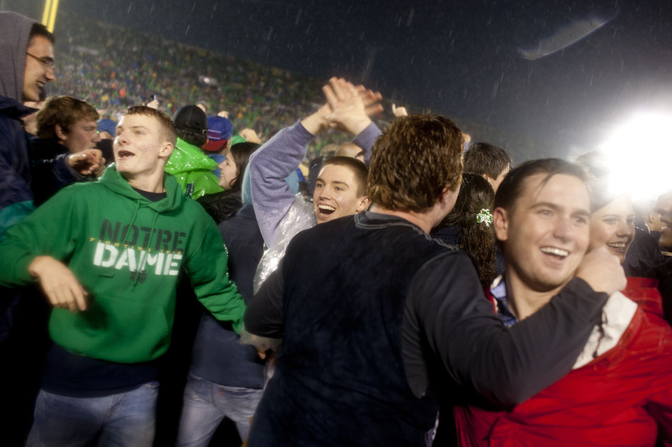 Students rush the field after 20-13 win against Stanford on Saturday, Oct. 13, 2012, at Notre Dame. (James Brosher/South Bend Tribune)