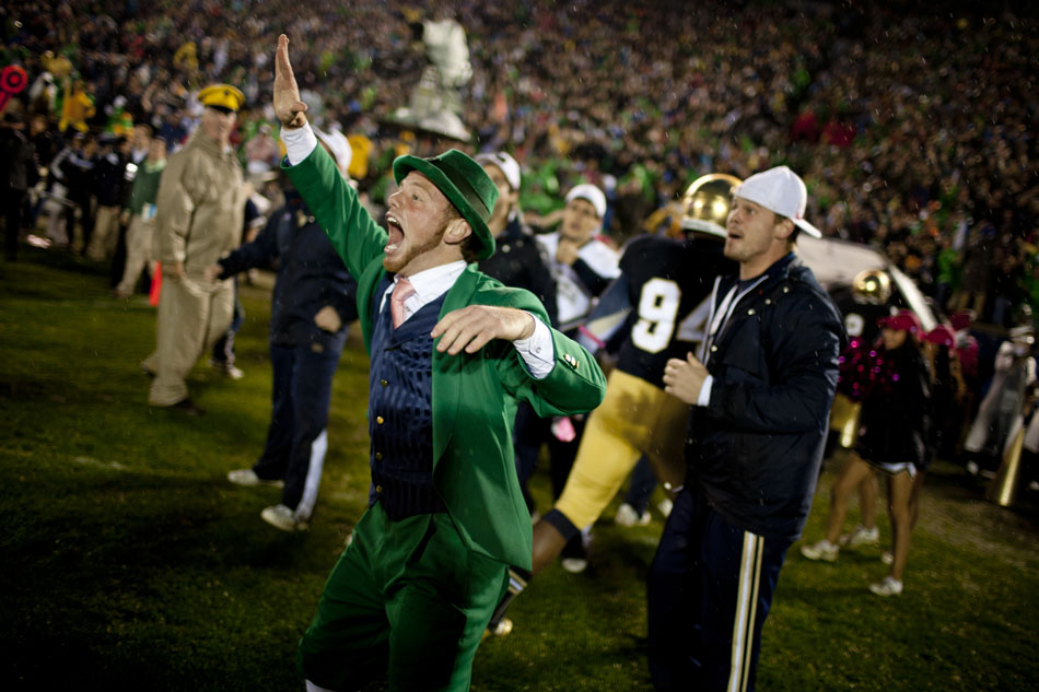 The Notre Dame Leprechaun rushes the field after 20-13 win against Stanford on Saturday, Oct. 13, 2012, at Notre Dame. (James Brosher/South Bend Tribune)