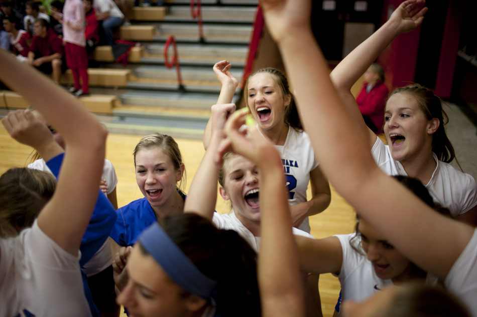 Marian players huddle up before the start of a volleyball sectional on Tuesday, Oct. 16, 2012, at Plymouth High School. (James Brosher/South Bend Tribune)