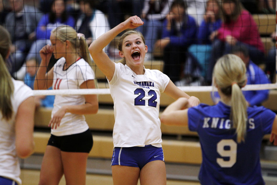Marian's Margaret Gibson (22) celebrates a score during a volleyball sectional on Tuesday, Oct. 16, 2012, at Plymouth High School. (James Brosher/South Bend Tribune)
