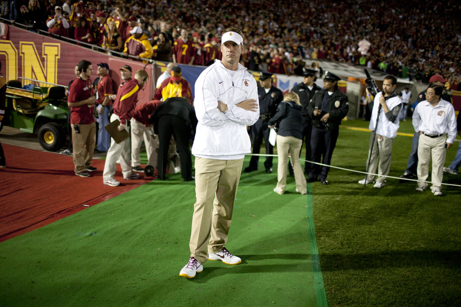 USC head coach Lane Kiffin waits on the field before the start of an NCAA college football game on Saturday, Nov. 24, 2012, at the Los Angeles Memorial Coliseum. (James Brosher/South Bend Tribune)