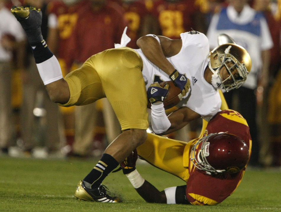 USC linebacker Lamar Dawson pulls down Notre Dame wide receiver TJ Jones (7) after a long reception during an NCAA college football game on Saturday, Nov. 24, 2012, at the Los Angeles Memorial Coliseum. (James Brosher/South Bend Tribune)