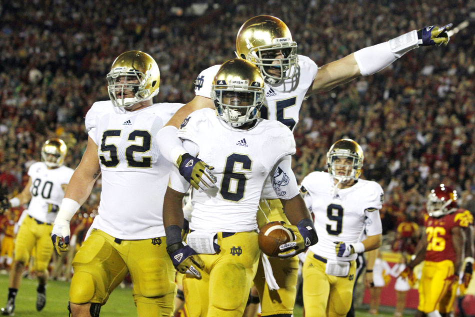 Notre Dame tight end Troy Niklas celebrates with Notre Dame running back Theo Riddick (6) after Riddick scored a rushing touchdown during an NCAA college football game on Saturday, Nov. 24, 2012, at the Los Angeles Memorial Coliseum. (James Brosher/South Bend Tribune)