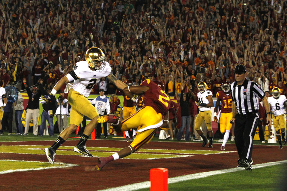 USC wide receiver Robert Woods beats Notre Dame cornerback Bennett Jackson (2) for a touchdown during an NCAA college football game on Saturday, Nov. 24, 2012, at the Los Angeles Memorial Coliseum. (James Brosher/South Bend Tribune)