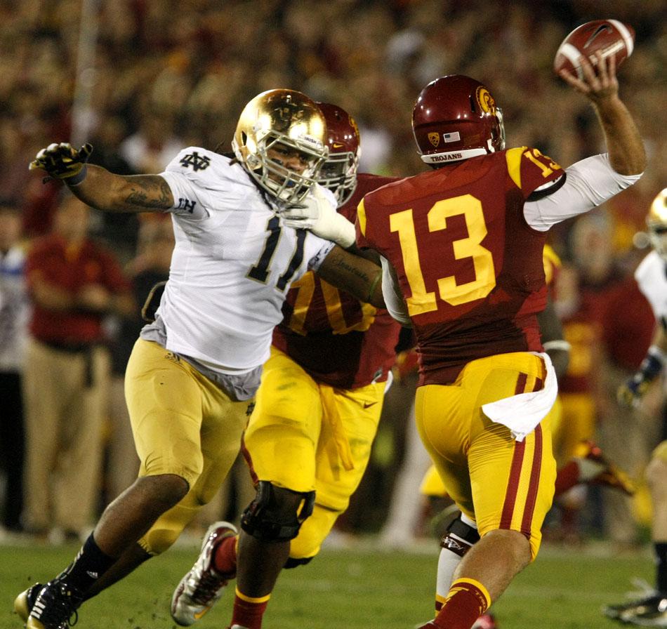 Notre Dame linebacker Ishaq Williams (11) pressures USC quarterback Max Wittek (13) during an NCAA college football game on Saturday, Nov. 24, 2012, at the Los Angeles Memorial Coliseum. (James Brosher/South Bend Tribune)
