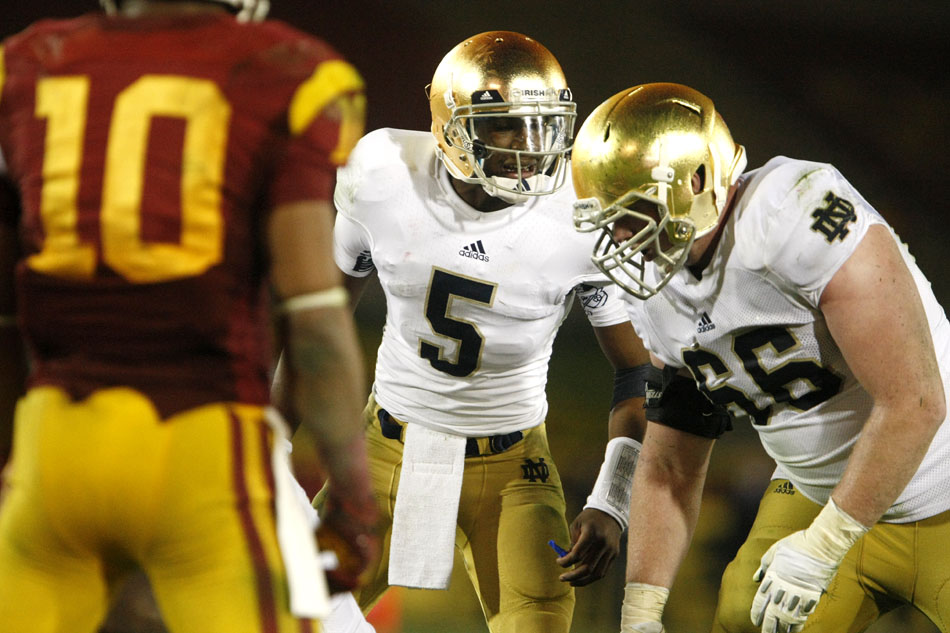 Notre Dame quarterback Everett Golson (5) changes a play at the line of scrimmage during an NCAA college football game on Saturday, Nov. 24, 2012, at the Los Angeles Memorial Coliseum. (James Brosher/South Bend Tribune)