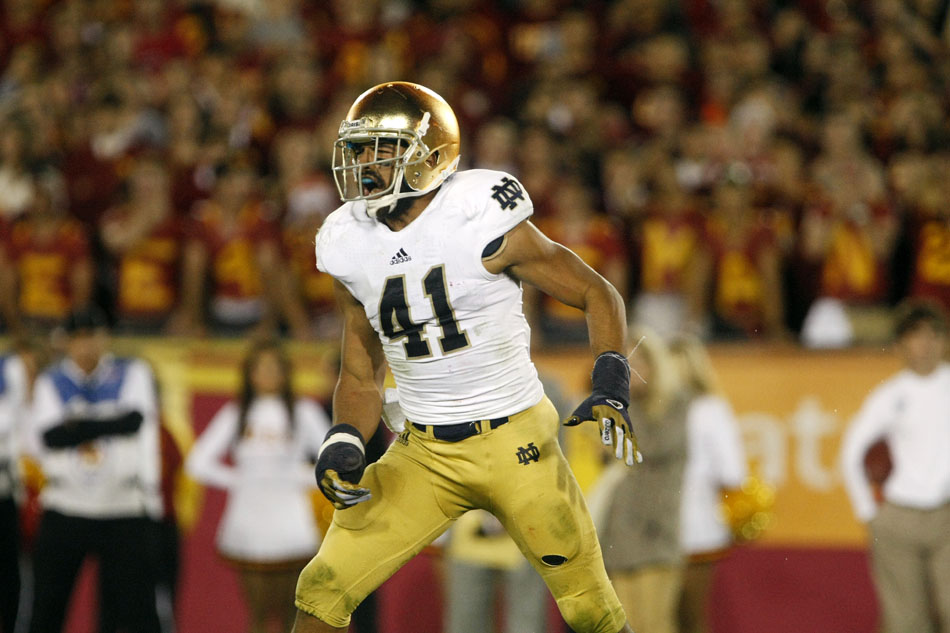 Notre Dame safety Matthias Farley celebrates a goal line stand stop on third down during an NCAA college football game on Saturday, Nov. 24, 2012, at the Los Angeles Memorial Coliseum. (James Brosher/South Bend Tribune)