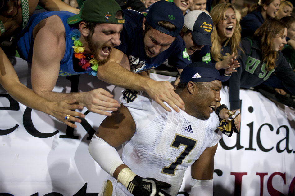 The crowd embraces Notre Dame defensive end Stephon Tuitt after a 22-13 win against USC on Saturday, Nov. 24, 2012, at the Los Angeles Memorial Coliseum. (James Brosher/South Bend Tribune)