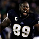 Notre Dame defensive end Kapron Lewis-Moore runs onto the field in celebration after Notre Dame held off Pittsburgh for a 29-26 win in three overtimes on Saturday, Nov. 3, 2012, at Notre Dame. (James Brosher/South Bend Tribune)